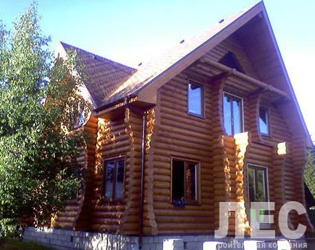 Дом из оцилиндрованного бревна ОБ-153 (9x9,5 м)